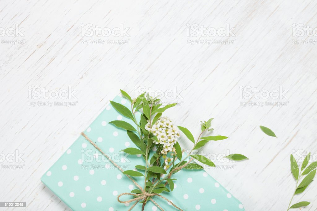 Top view on decorated birthday gift with garden tree branch and...