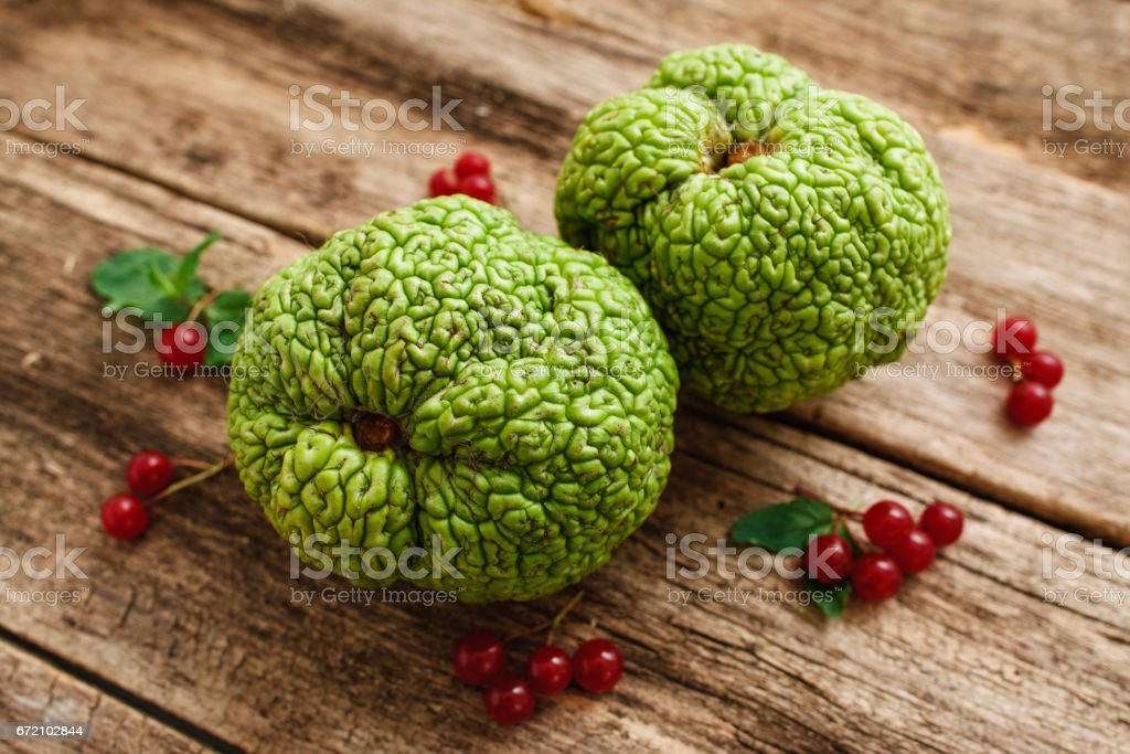 Top view on green exotic fruits with red berries stock photo