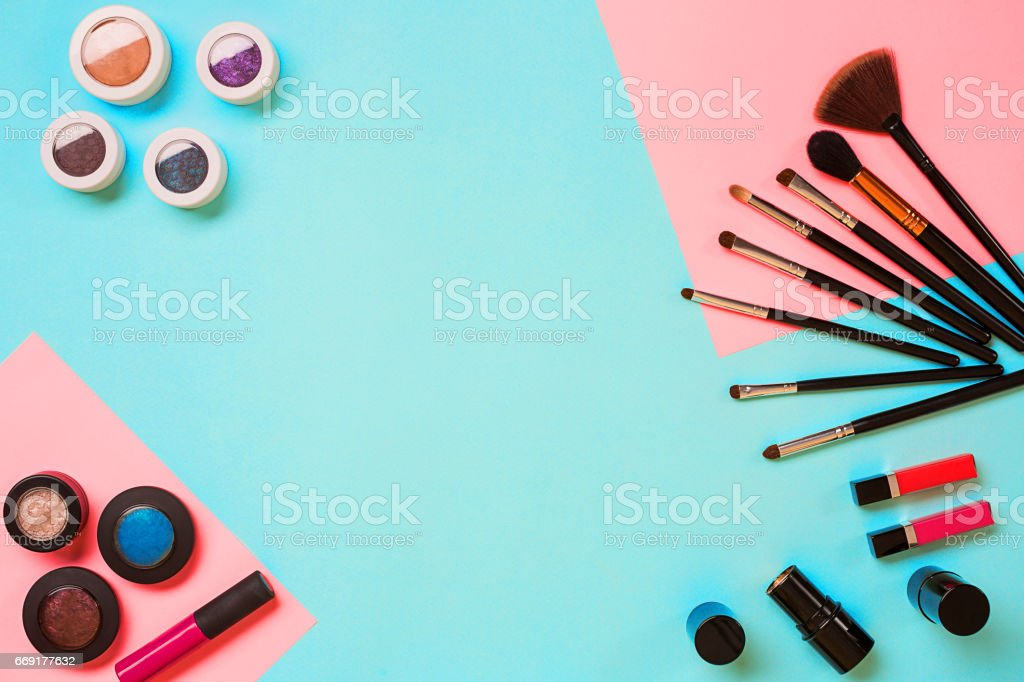 Top view on set of cosmetics for professional make-up on blue background stock photo