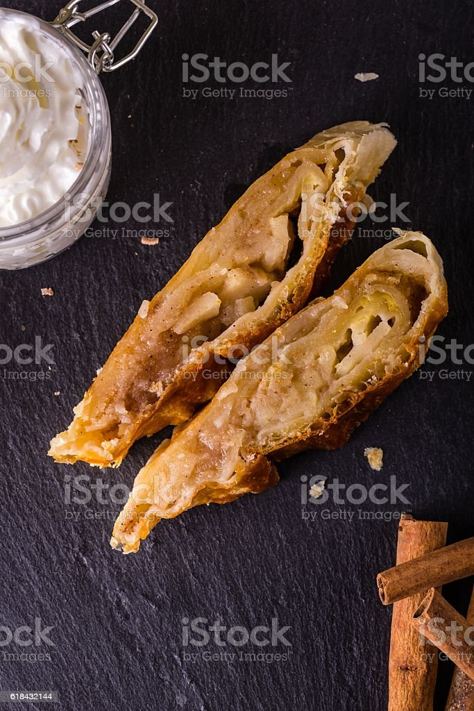Top view on two portions of apple-strudel on slate stone stock photo