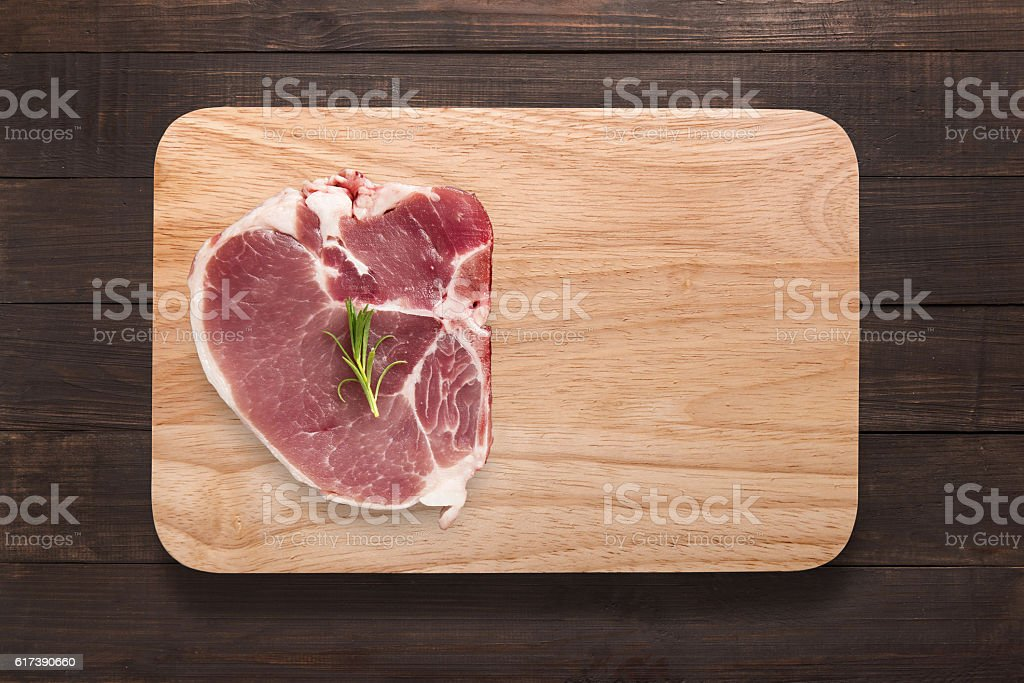 Top view raw pork chop steak on cutting board. stock photo