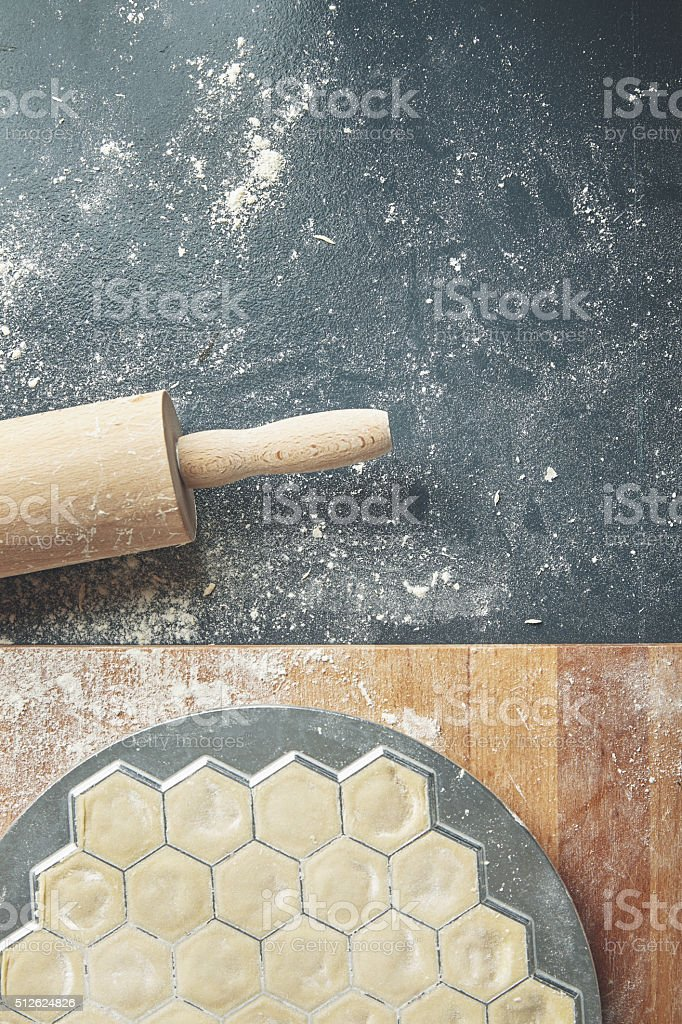 Top view red ravioli mold isolated on blue old table stock photo