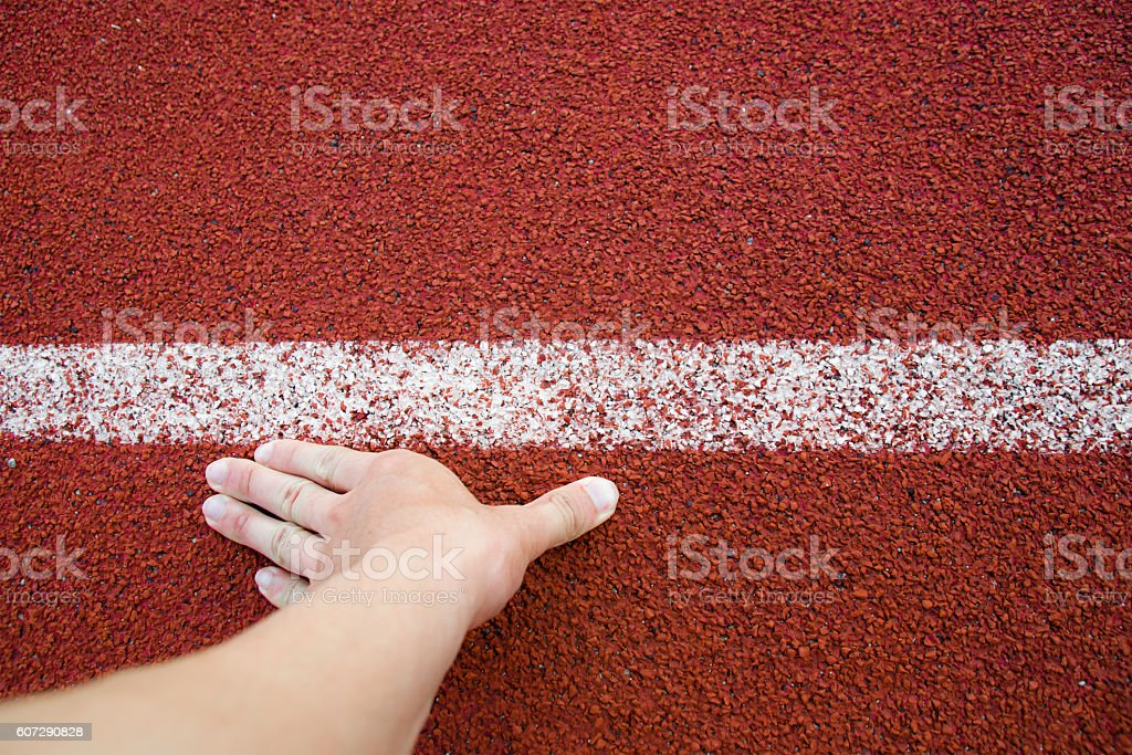 Top view Runner Man Hand in position Track White Lines stock photo