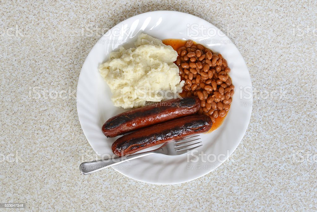 top view sausages baked beans and mashed potato stock photo