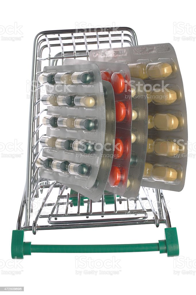 Top view shopping cart with different pills stock photo