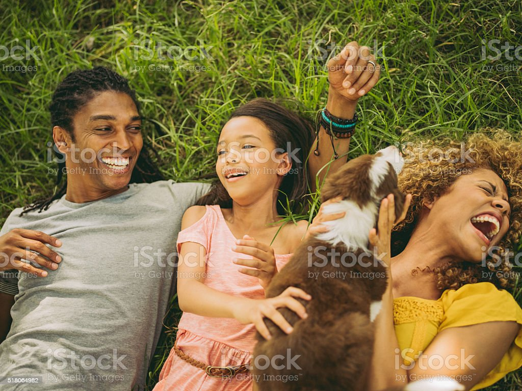 Top view shot of African-American family lying on their backs stock photo