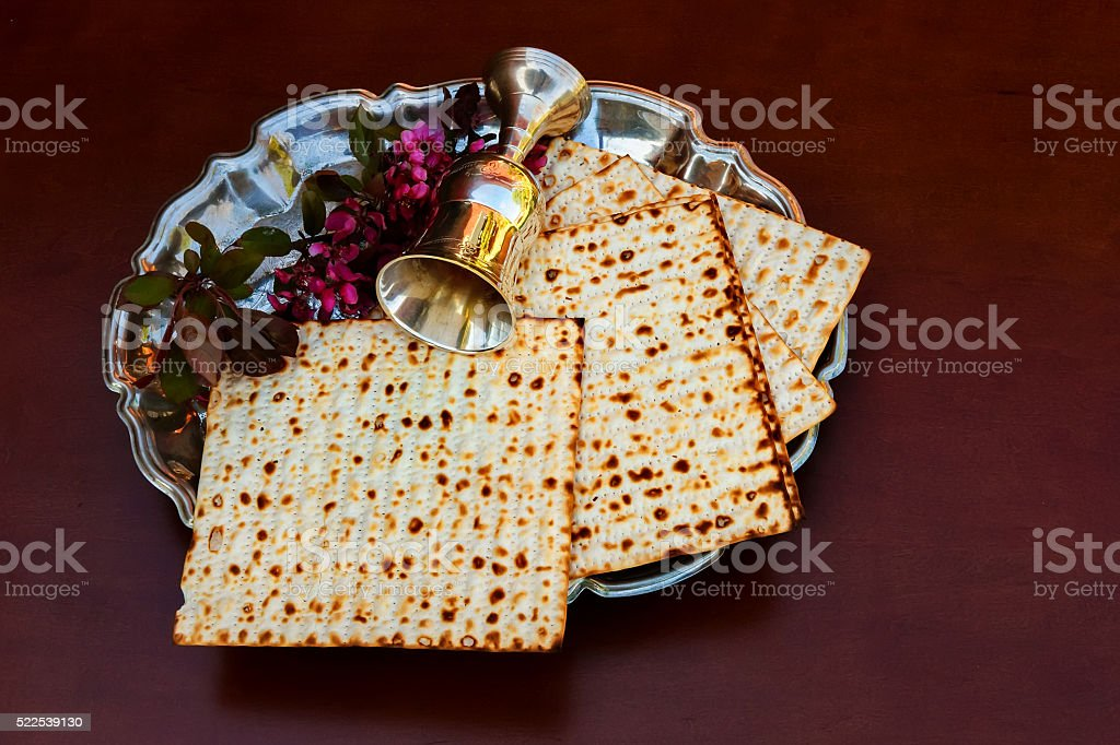 Top view  wine and matzoh jewish passover bread over wooden stock photo