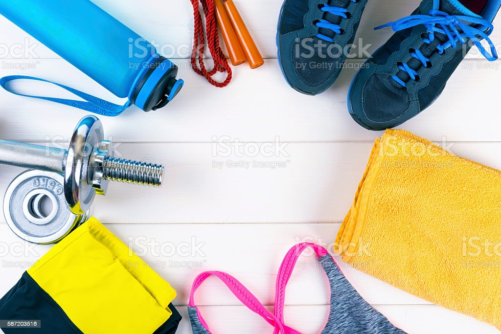 top view with fitness equipment on white wooden background stock photo