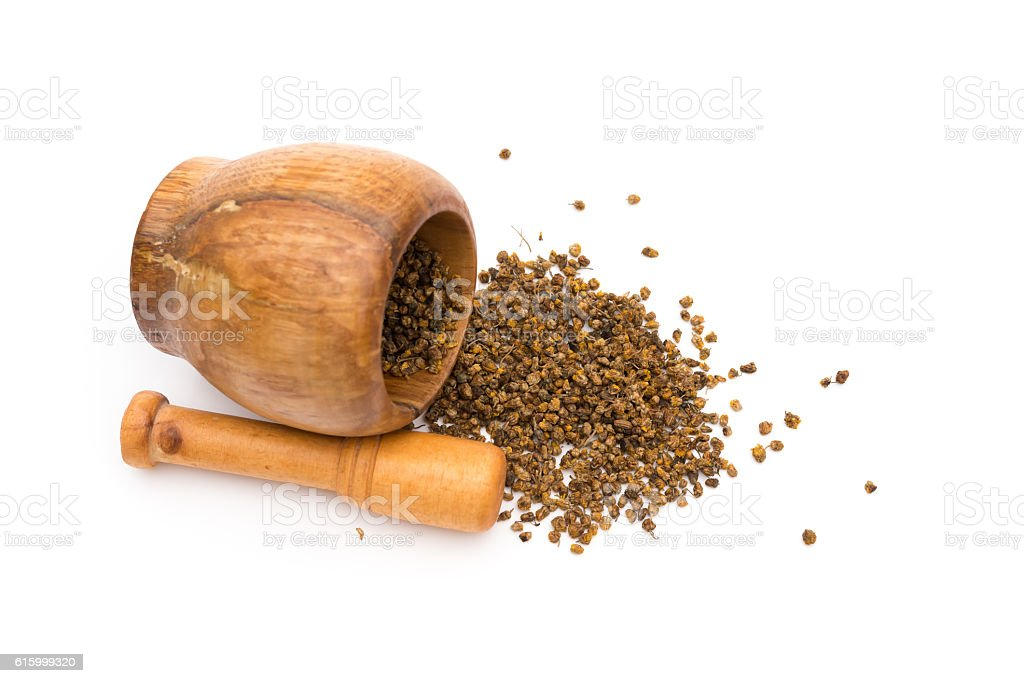 top view wooden mortar and pestle with flos chrysanthemi indic stock photo
