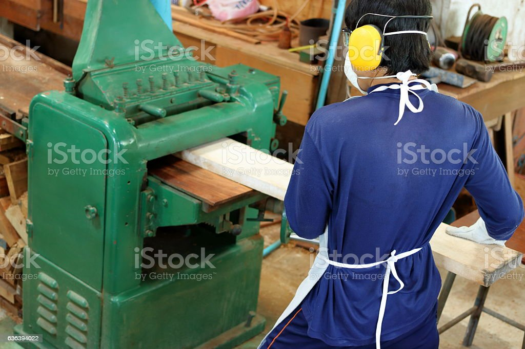 Top view,Worker is working with planing of wood machine. stock photo