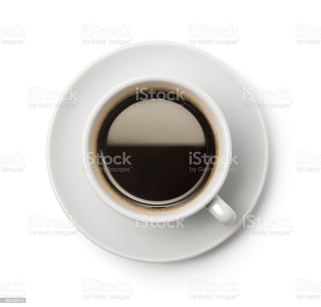 A top-down picture of a cup of coffee on a plate stock photo