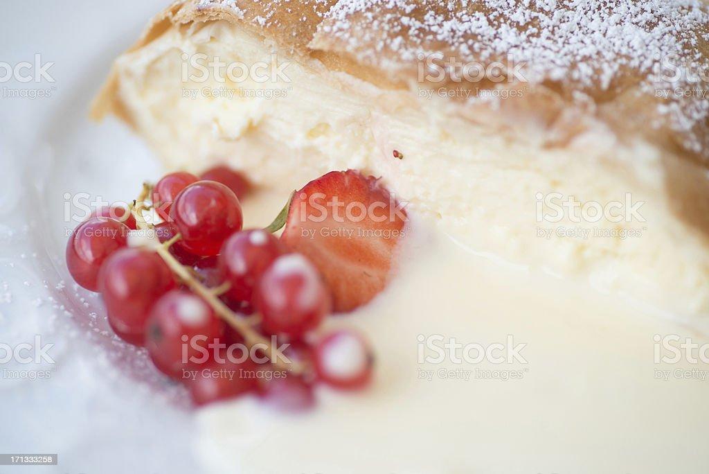 Topfenstudel mit Vanillesauce Johannisbeere und Erdbeere Puderzucker stock photo
