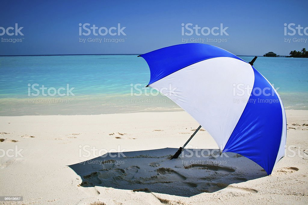 topical beach with umbrella royalty-free stock photo