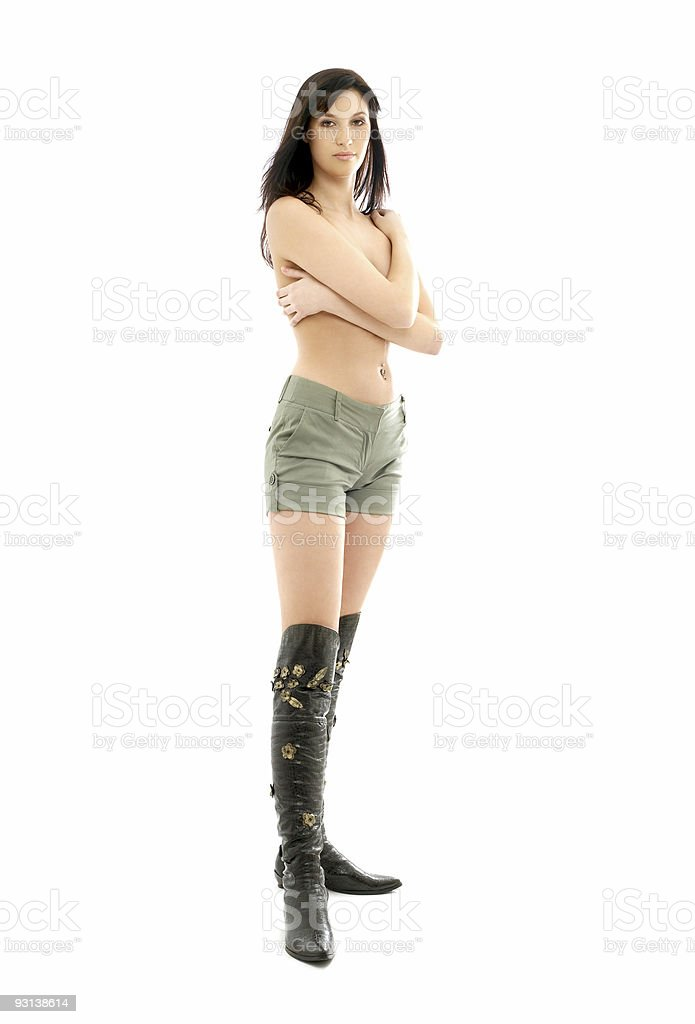 topless brunette in green shorts and boots royalty-free stock photo