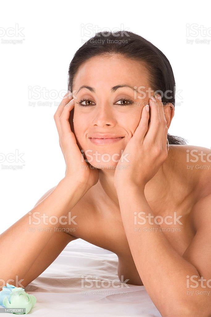 Topless ethnic friendly smiling woman lying in spa royalty-free stock photo