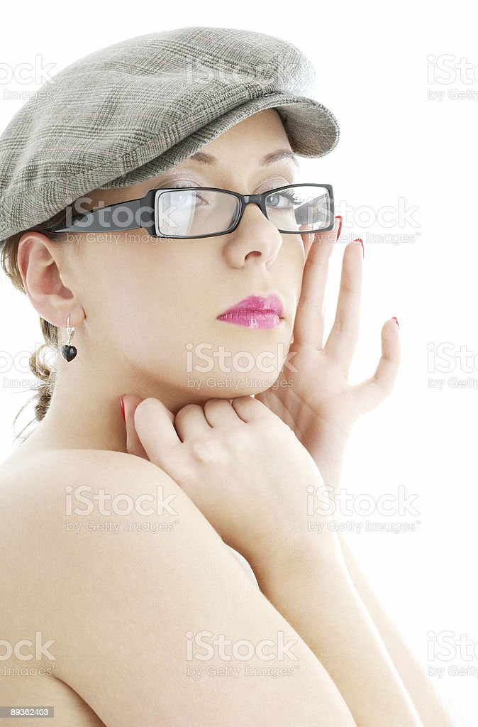 topless lady in black plastic eyeglasses and cap royalty-free stock photo