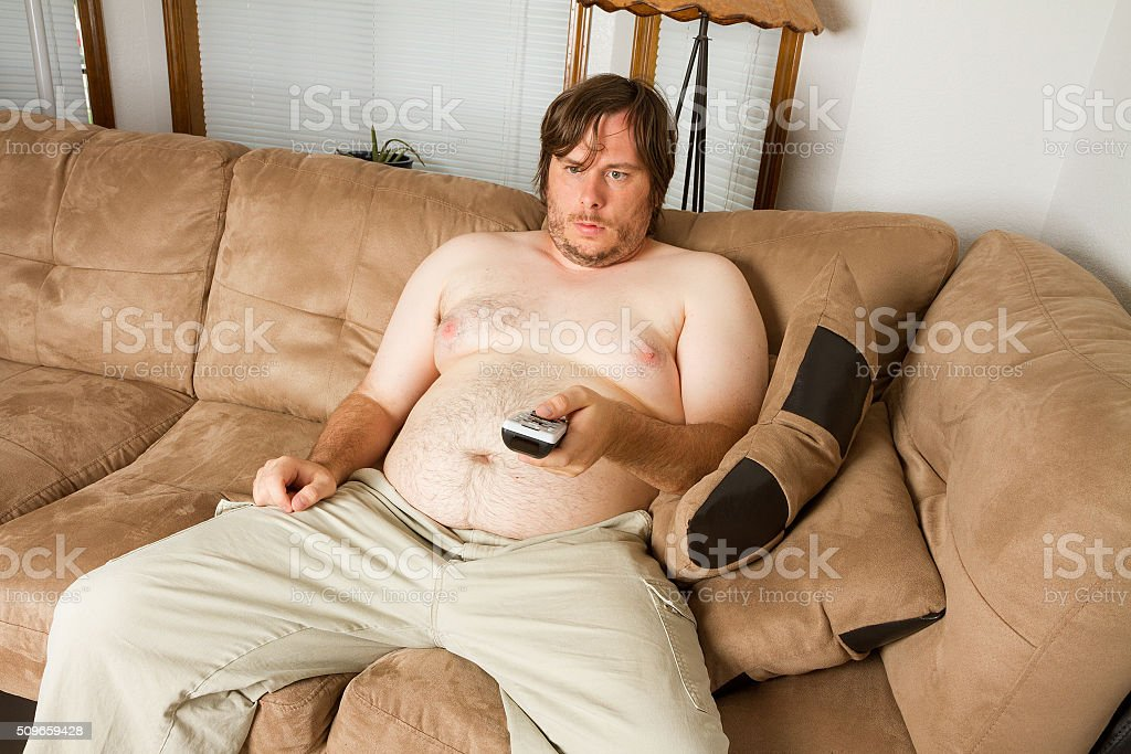 Topless man enjoying the TV stock photo