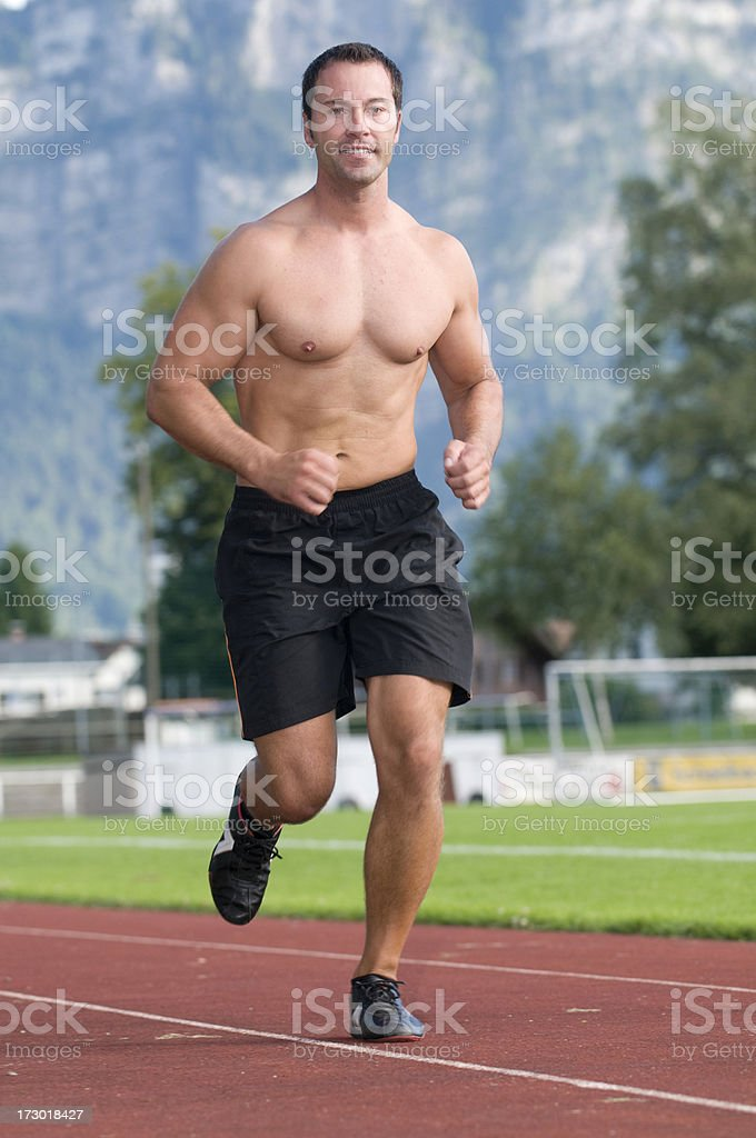 topless man running royalty-free stock photo