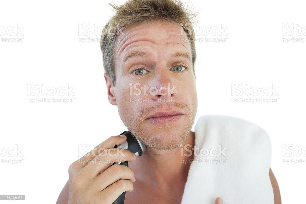 Topless man shaving his beard royalty-free stock photo