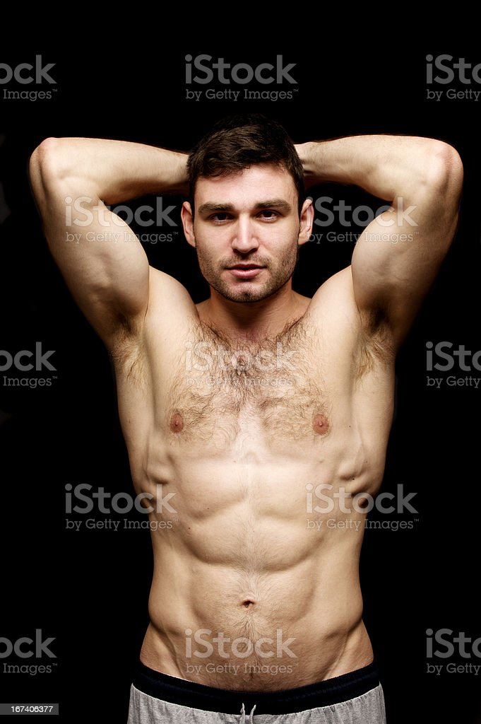 Topless man stood on a black background royalty-free stock photo