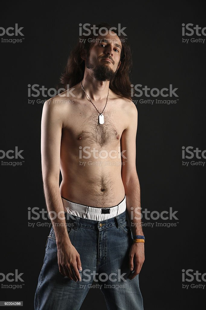 Topless slim rebel with long hair isolated on black background royalty-free stock photo