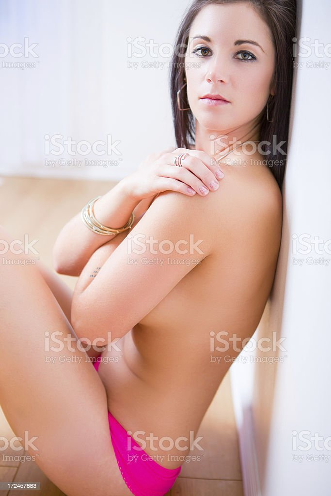 Topless woman sitting on floor royalty-free stock photo