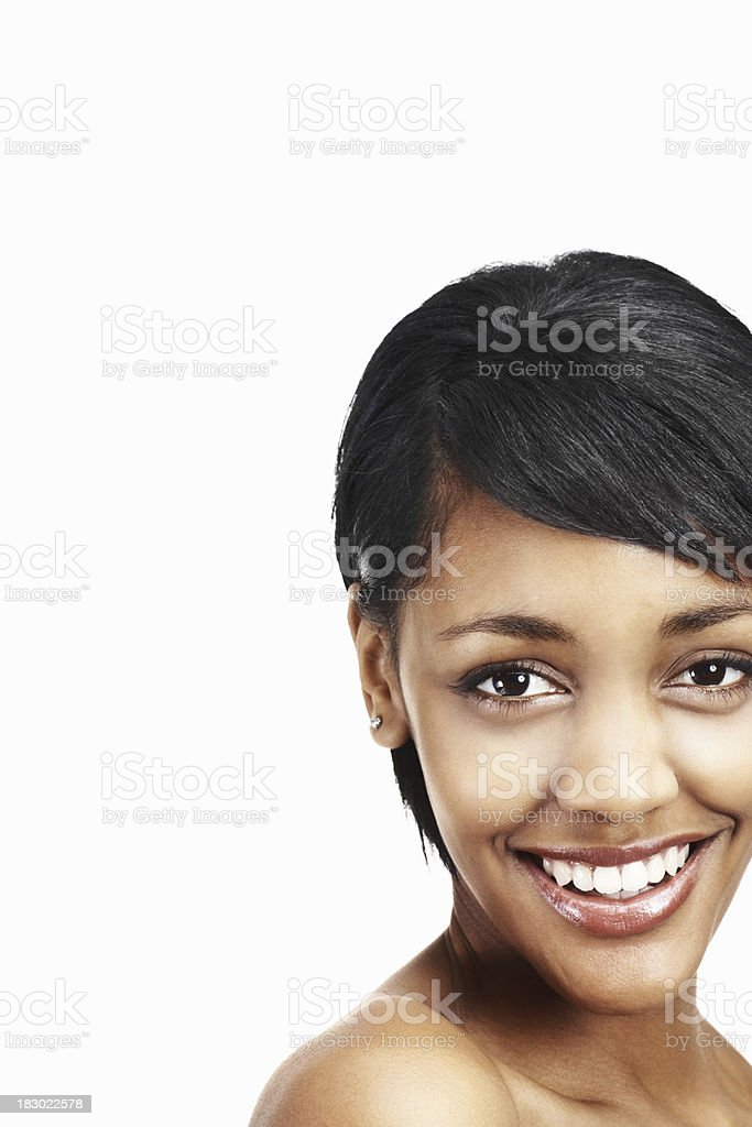 Topless young female smiling against white background royalty-free stock photo