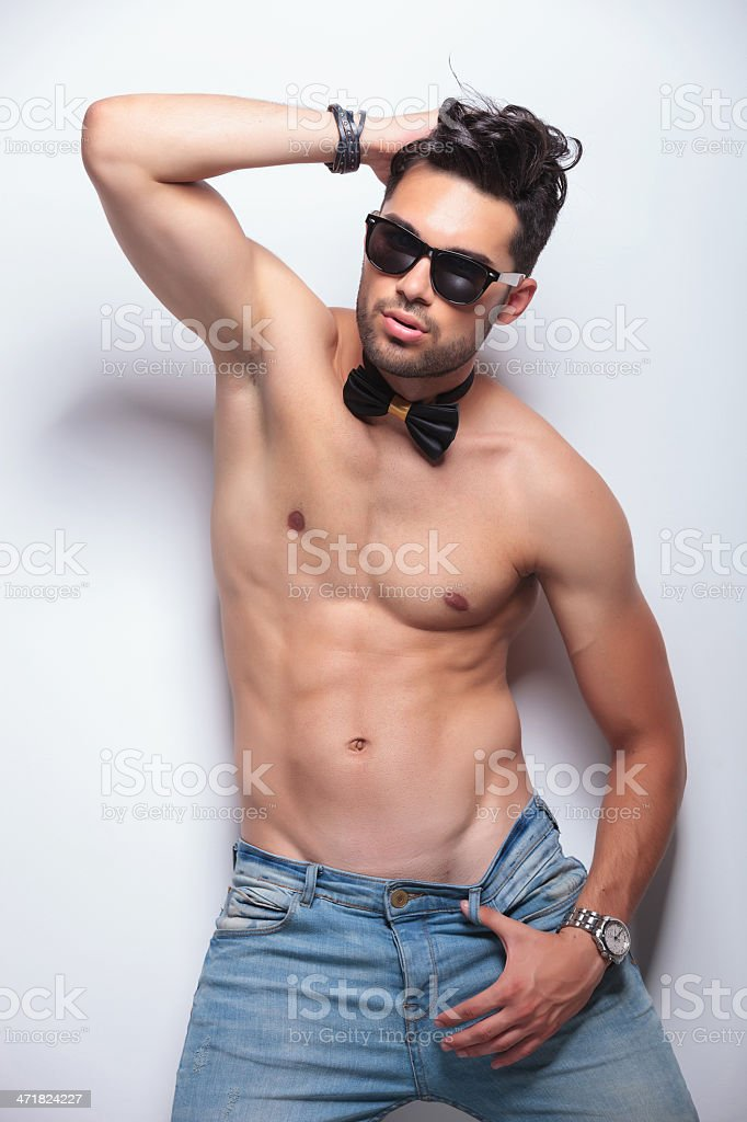 topless young man in a sexy pose royalty-free stock photo