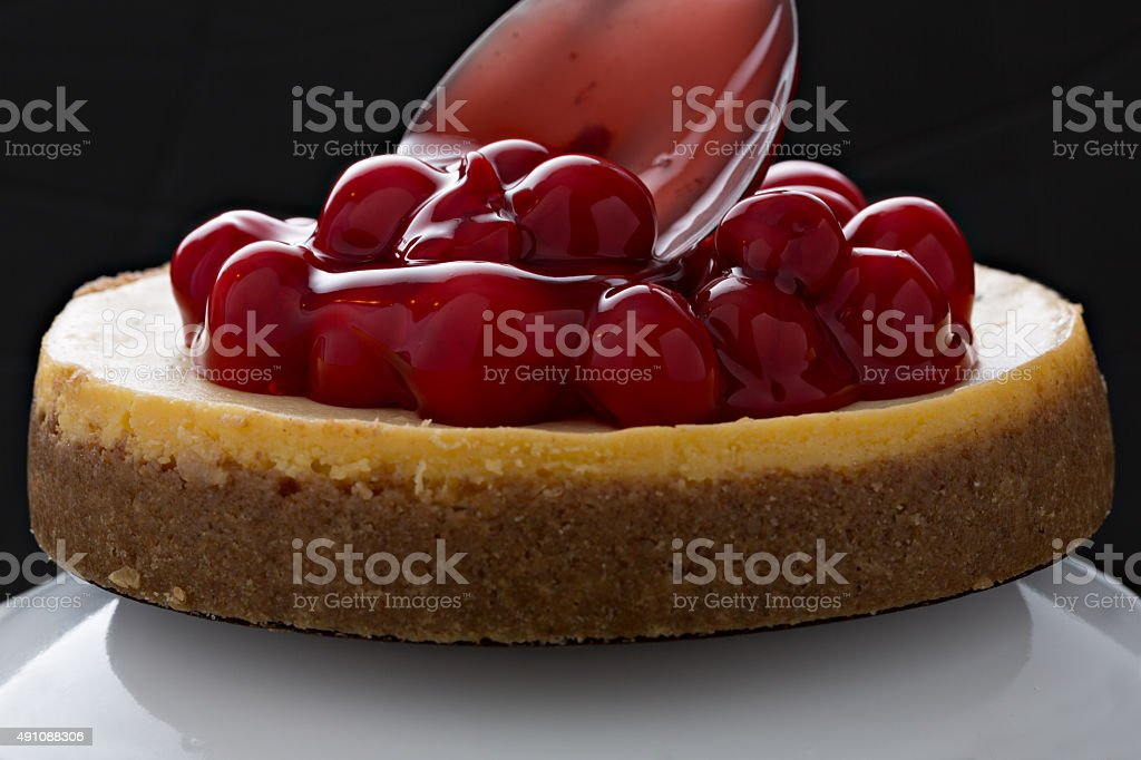 Topping A Cherry Cheesecake stock photo