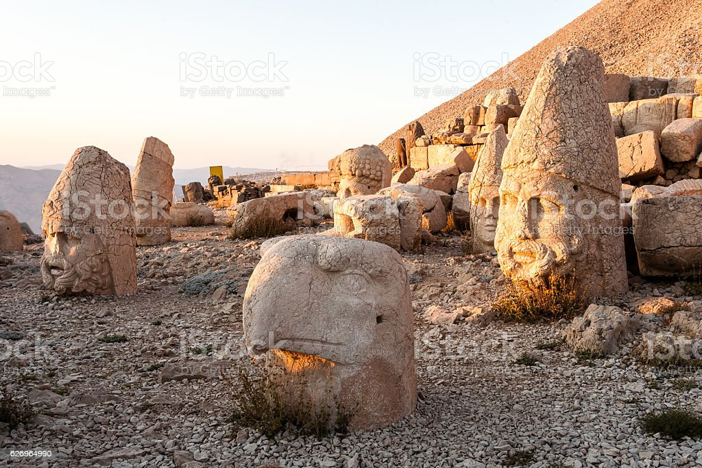 Toppled heads of the gods at the top of Nemrut stock photo