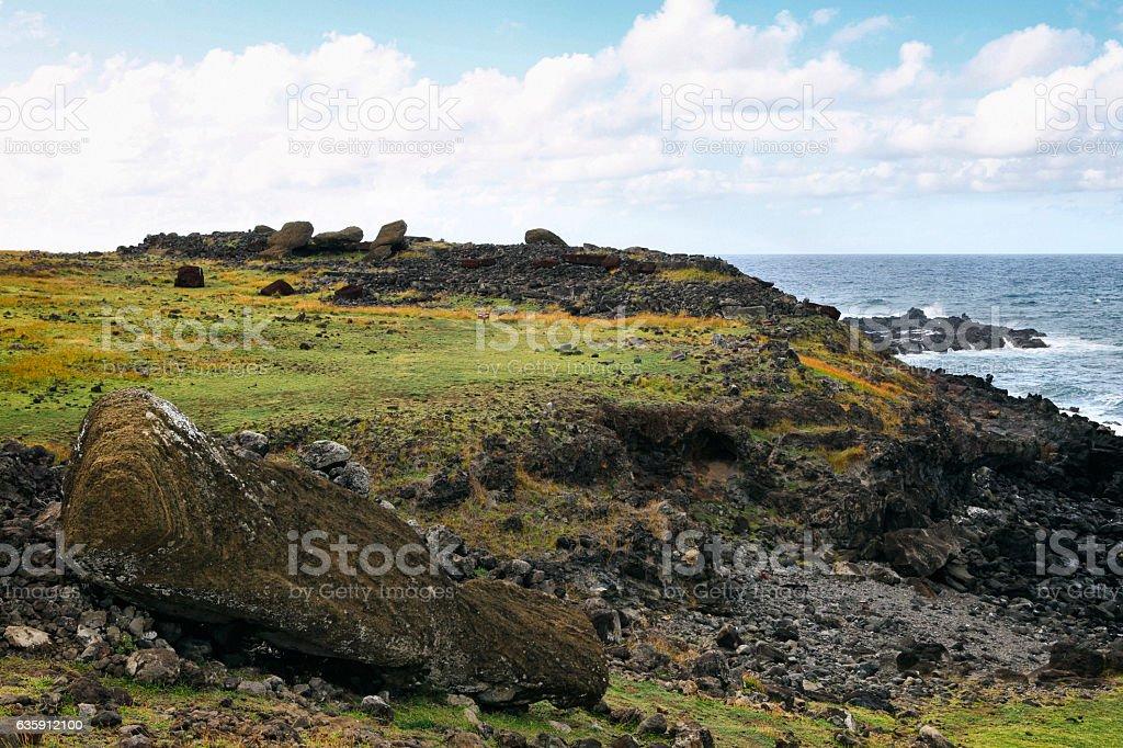 Toppled Moai along the coast of Easter Island, Chile stock photo