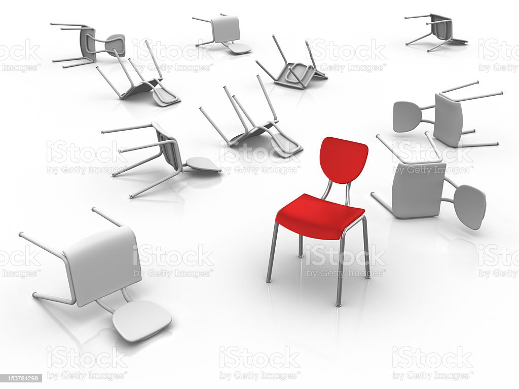 Toppled white chairs and a single standing red chair royalty-free stock photo
