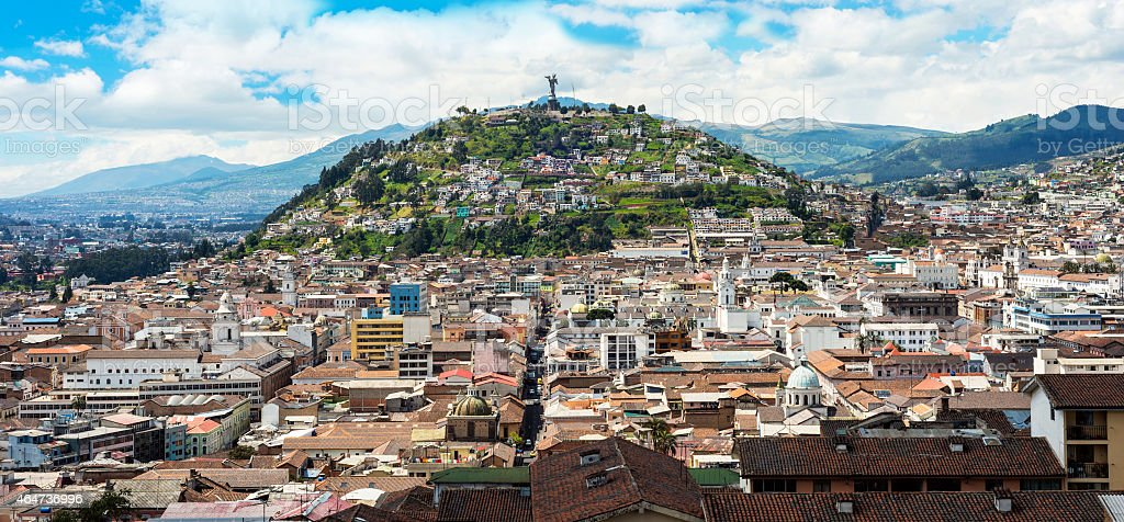 Tops of buildings on mountains in Quito stock photo