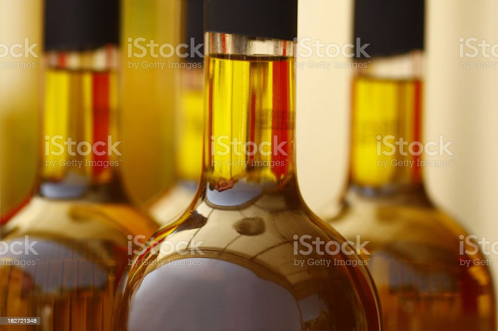Tops of glass bottles filled with brown liquid stock photo