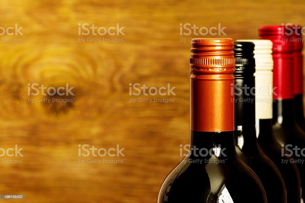 Tops of wine bottles with screw caps stock photo