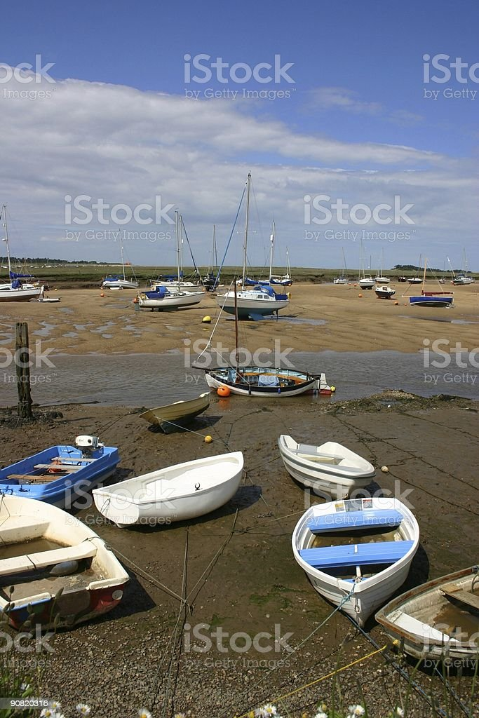 topsy-turvy boats resting at low tide royalty-free stock photo