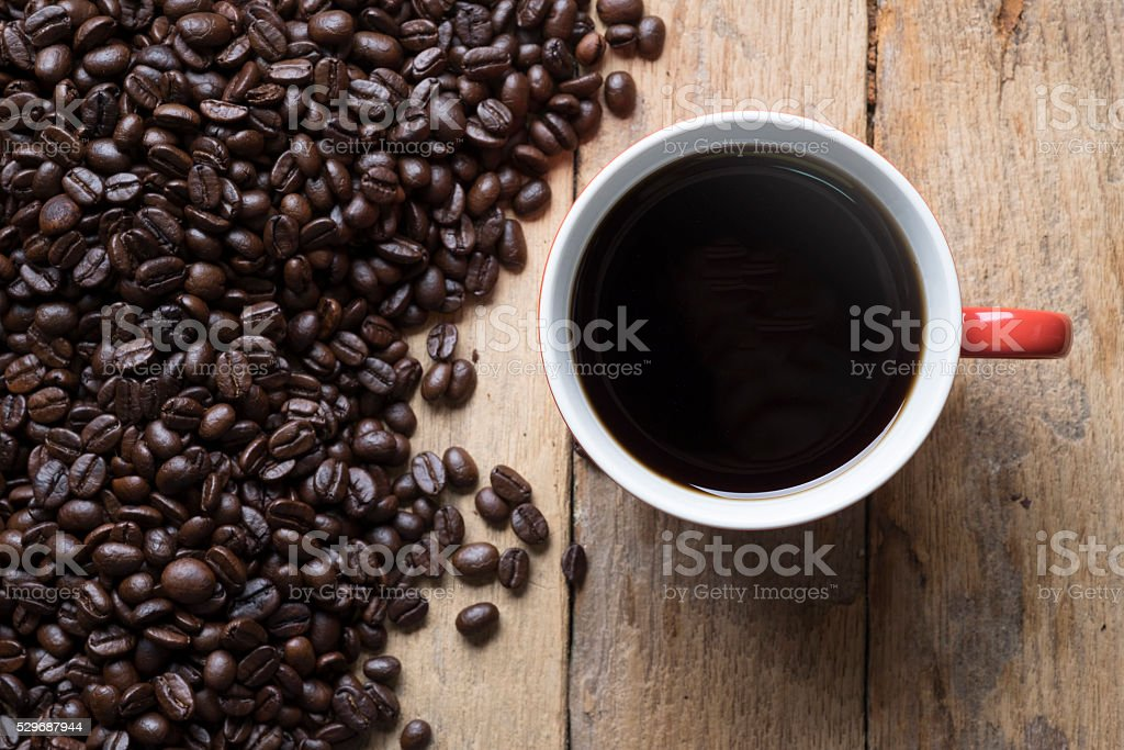 Topview of the red cup of coffee and coffee beans. stock photo