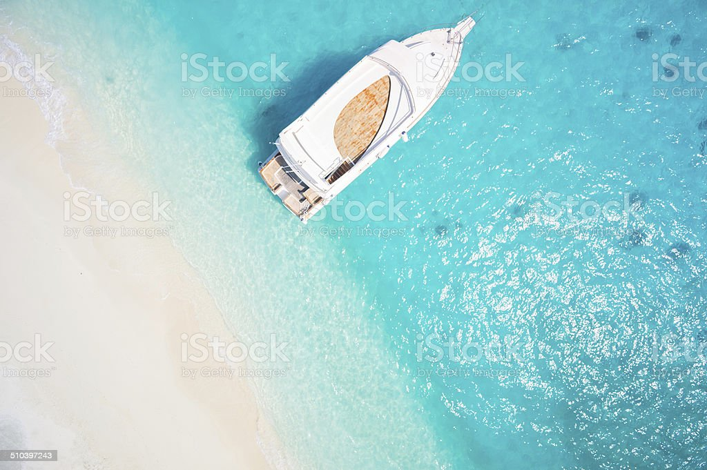 topview yacht in tropical lagoon stock photo