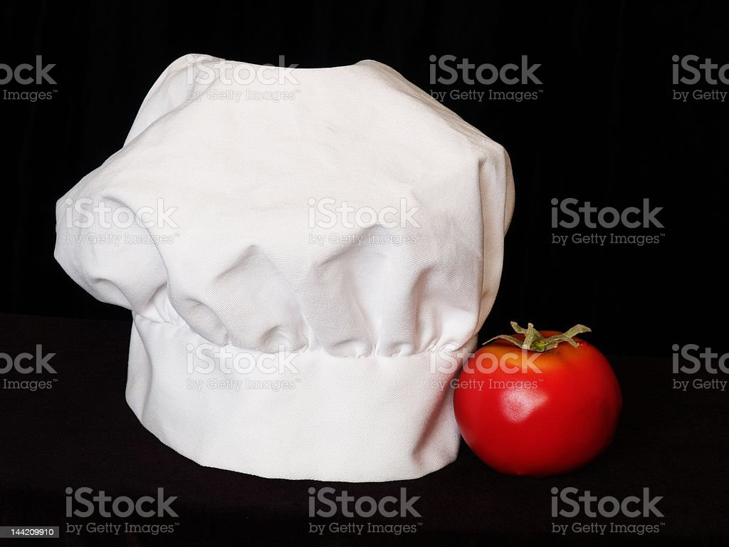Toque and tomato royalty-free stock photo
