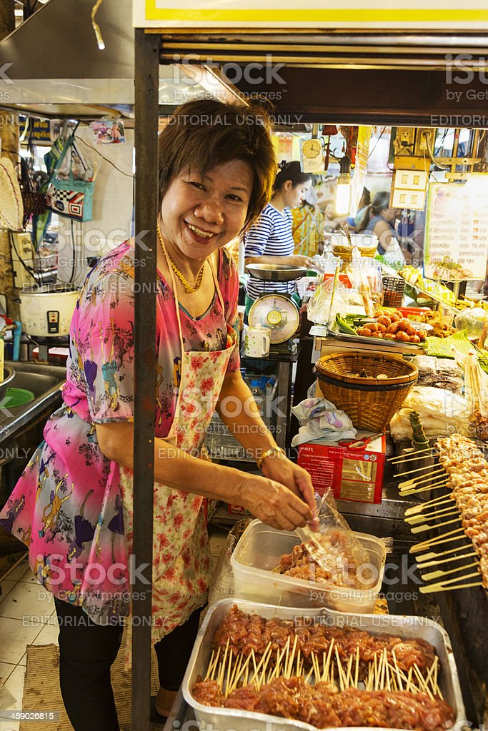 OR Tor Kor farmers market in Bangkok. Cooking satay. royalty-free stock photo