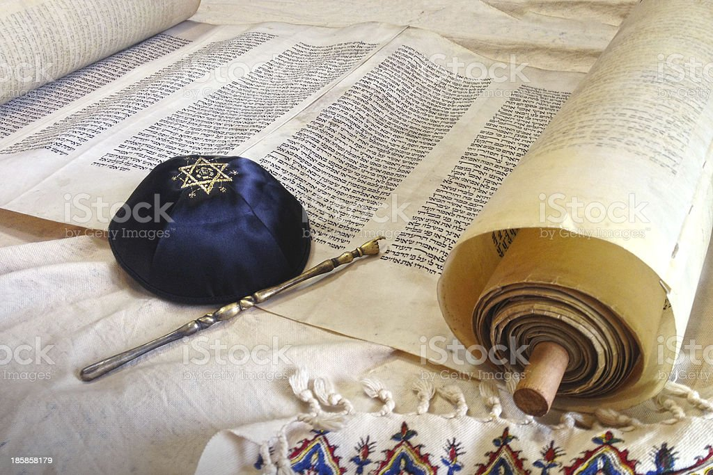 Torah scroll on Synagogue table with Kippah and Talith stock photo