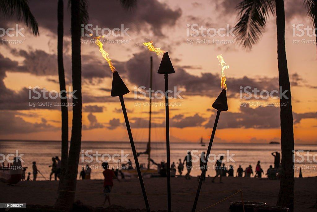 Torch Lighting in Waikiki on Sunset stock photo