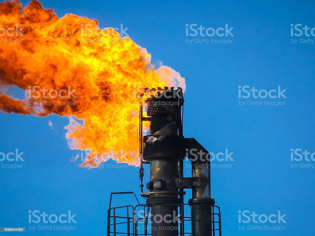 Torch system on an oil field stock photo