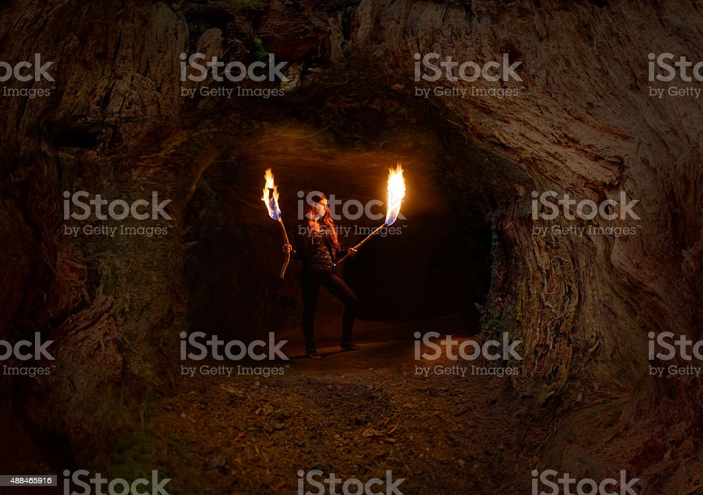 Torch woman in Halloween Cave stock photo