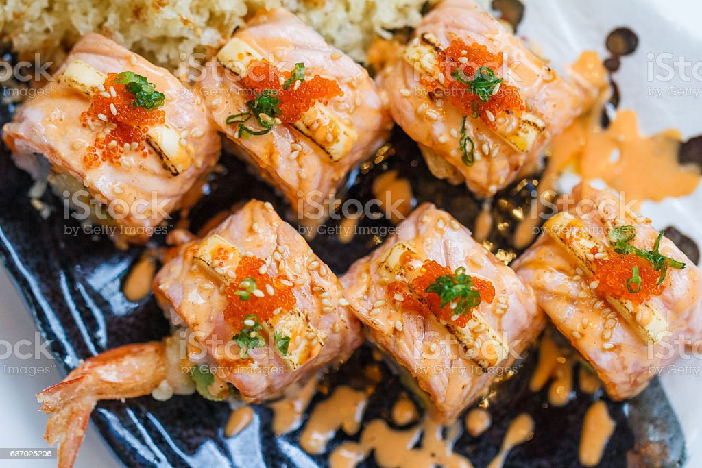 Torched Salmon Roll with Prawn Tempura Inside. stock photo