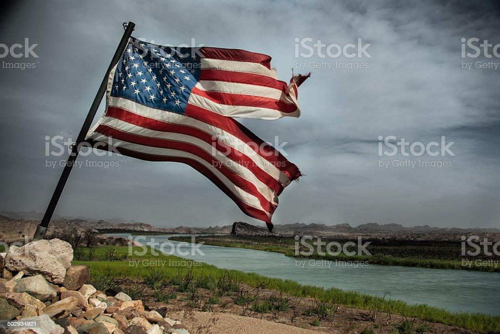 Torn American Flag stock photo
