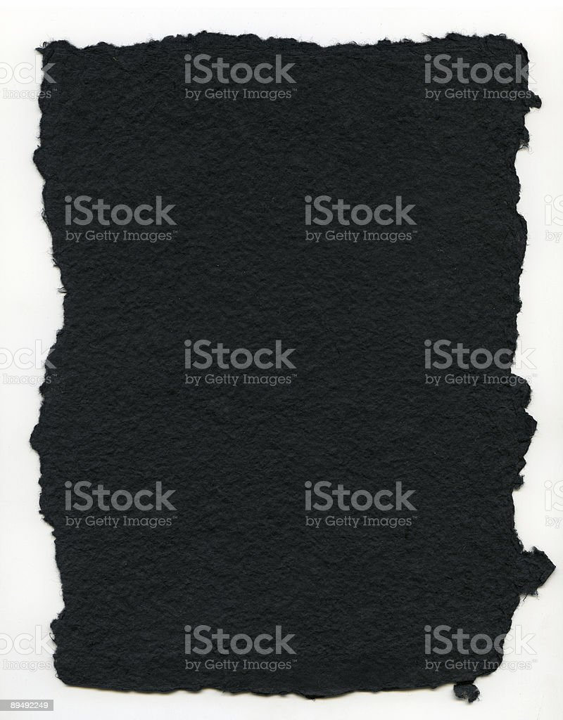 XXL Torn black pulp paper stock photo