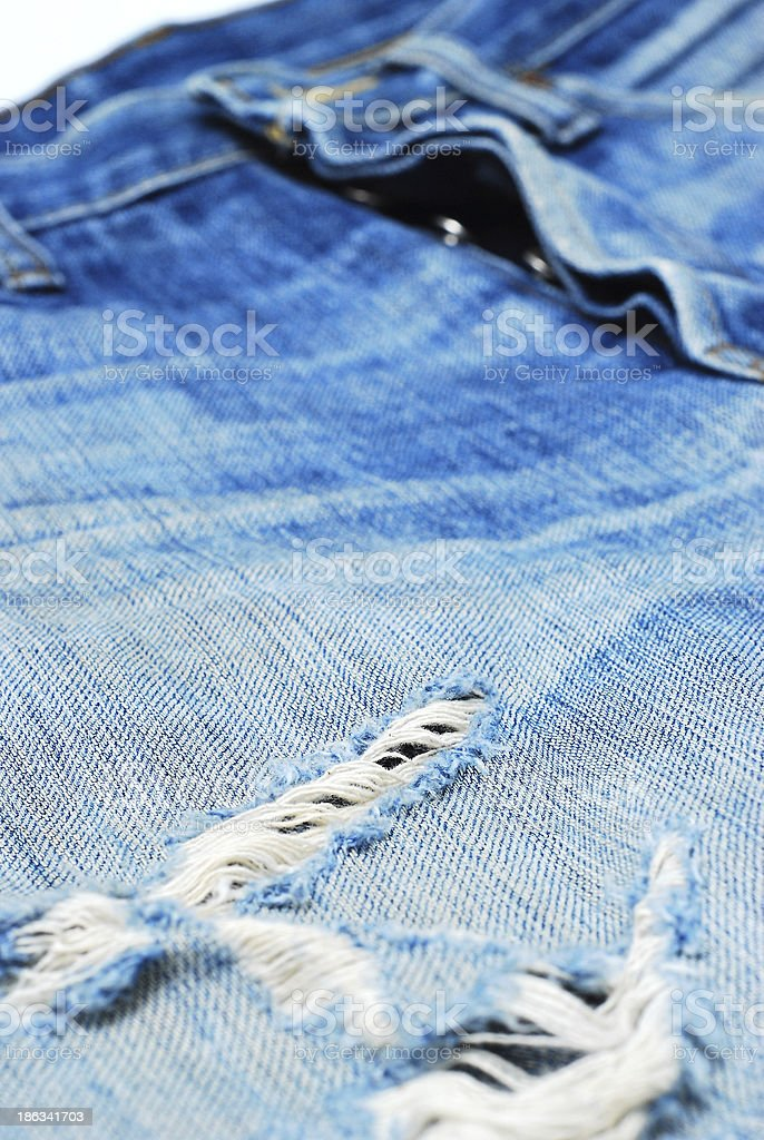 torn blue jeans on white background royalty-free stock photo