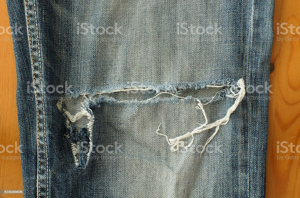 Torn blue jeans stock photo