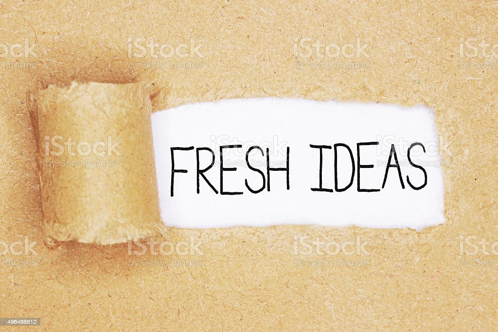 torn brown paper with the words 'fresh ideas' stock photo